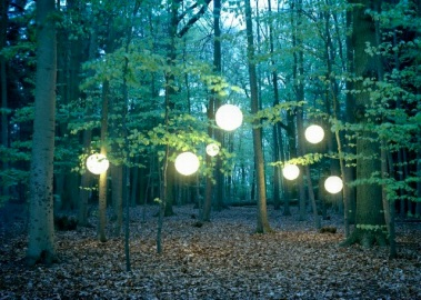 Danbury, Essex, England, UK --- Lanterns hanging from trees in forest --- Image by © Lottie Davies/cultura/Corbis